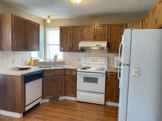 Photo 4: 2705 46 Street SE in Calgary: Dover Semi Detached for sale : MLS®# A1106612