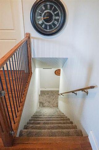 Photo 24: 102 Morris Place: Didsbury Detached for sale : MLS®# A1045288
