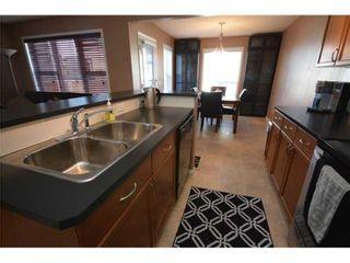 Photo 10: 156 Cimarron Grove Crescent: Okotoks Detached for sale : MLS®# A1116396