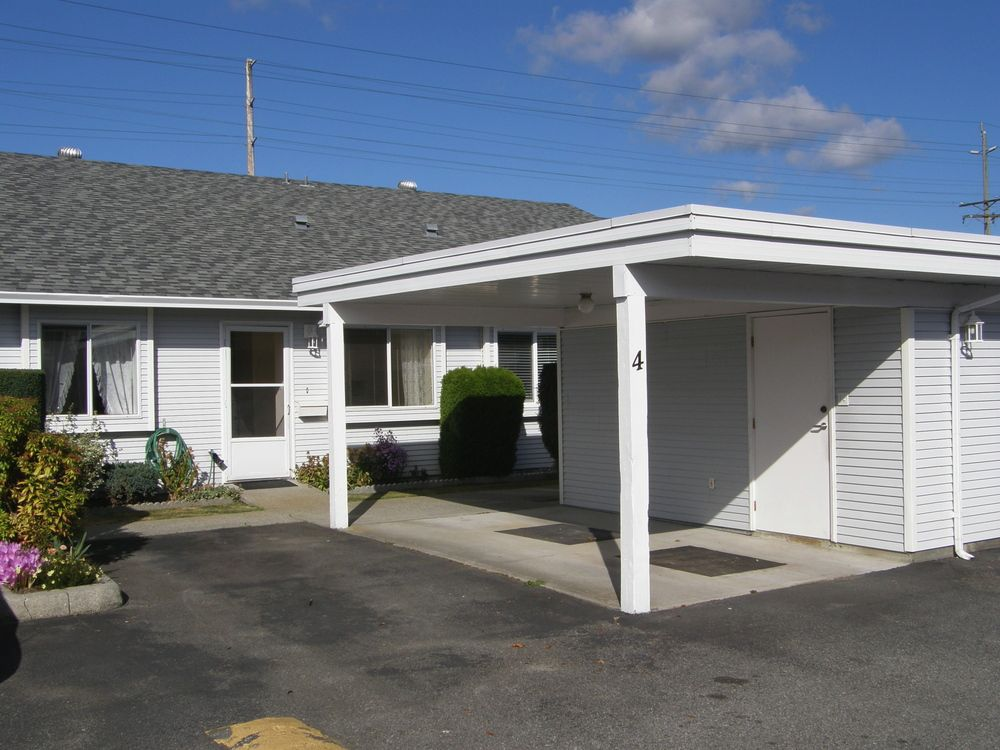 Front of unit showing carport and extra parking stall (included)