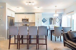 Photo 3: 639 101 SUNSET Drive: Cochrane House for sale : MLS®# C4143870