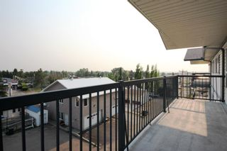 Photo 3: 404 4514 54 Avenue: Olds Apartment for sale : MLS®# A1130006