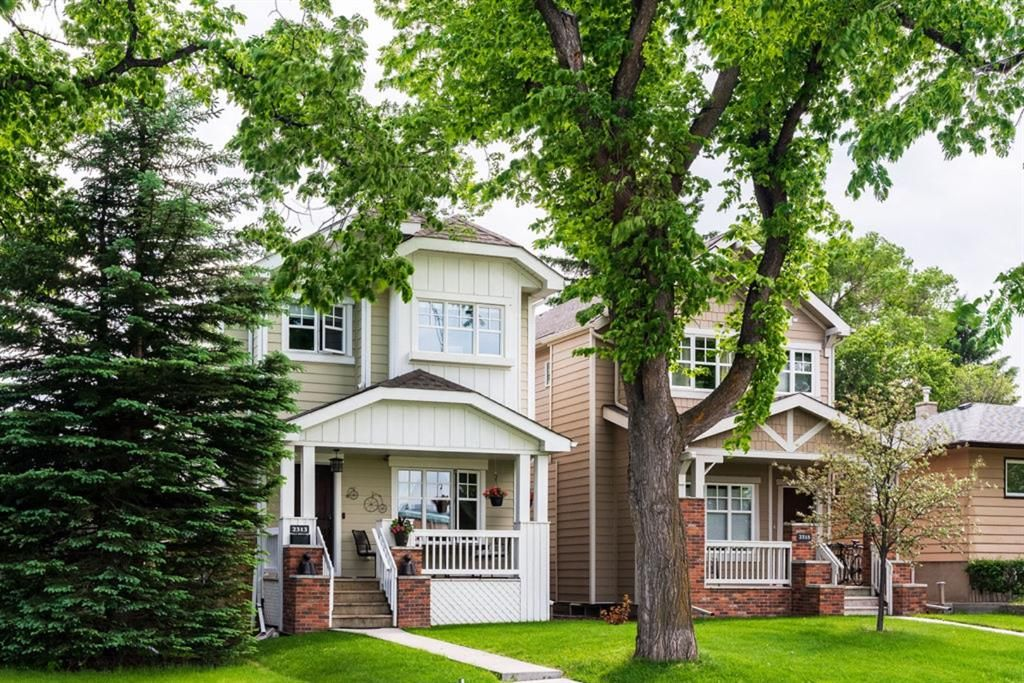 DETACHED HOME WITH DETACHED DOUBLE GARAGE on a beautiful mature tree lined street facing the high school football field!