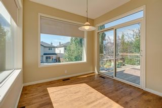 Photo 8: 144 Tuscany Meadows Heath NW in Calgary: Tuscany Detached for sale : MLS®# A1030703