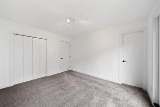 Photo 18: 316 Queen Alexandra Road SE in Calgary: Queensland Detached for sale : MLS®# A1142410
