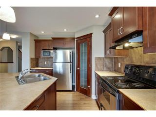 Photo 9: 788 Luxstone Landing SW: Airdrie House for sale : MLS®# C4083627