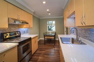 """Photo 3: 13 849 TOBRUCK Avenue in North Vancouver: Hamilton Townhouse for sale in """"Garden Terrace"""" : MLS®# R2018127"""
