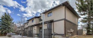 Photo 1: 25 2210 Oakmoor Drive SW in Calgary: Palliser Row/Townhouse for sale : MLS®# A1092657