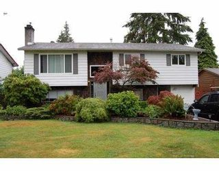 Photo 1: 2410 PATRICIA Avenue in Port_Coquitlam: Woodland Acres PQ House for sale (Port Coquitlam)  : MLS®# V783034