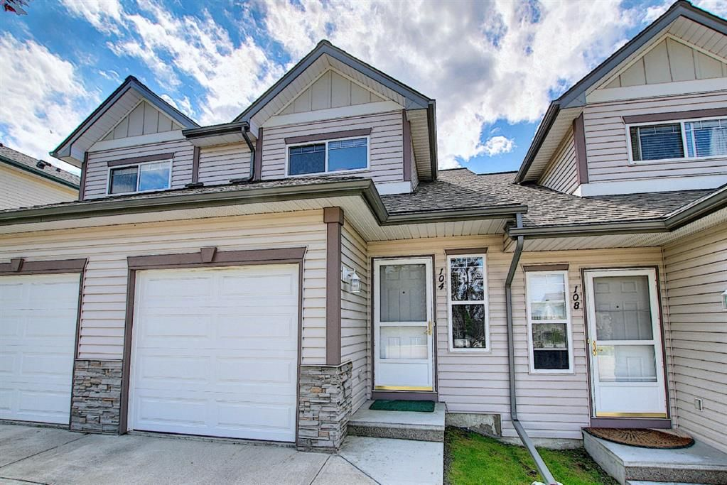 Main Photo: 104 Millview Green SW in Calgary: Millrise Row/Townhouse for sale : MLS®# A1120557