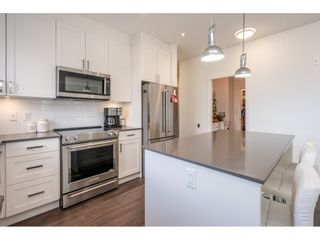 """Photo 14: 204 16380 64TH Avenue in Surrey: Cloverdale BC Condo for sale in """"The Ridge at Bose Farm"""" (Cloverdale)  : MLS®# R2535552"""
