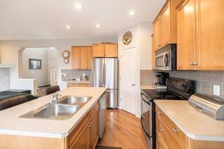 Photo 7: 403 CIMARRON Boulevard: Okotoks House for sale : MLS®# C4170215
