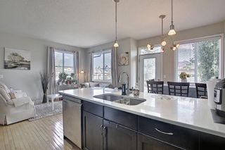 Photo 8: 6 Everridge Gardens SW in Calgary: Evergreen Row/Townhouse for sale : MLS®# A1145824