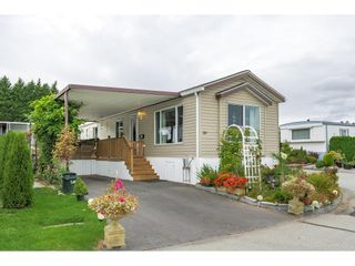 """Photo 1: 38 15875 20 Avenue in Surrey: King George Corridor Manufactured Home for sale in """"Sea Ridge Bays"""" (South Surrey White Rock)  : MLS®# R2616813"""