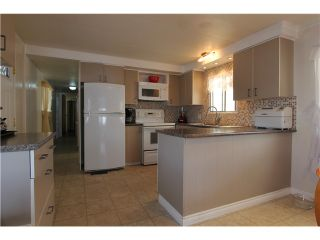 """Photo 1: 288 201 CAYER Street in Coquitlam: Maillardville Manufactured Home for sale in """"WILDWOOD PARK"""" : MLS®# V1007219"""
