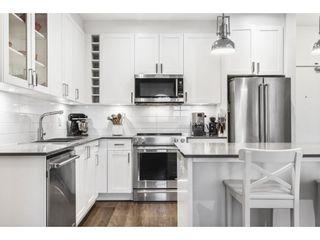 "Photo 3: 411 16380 64 Avenue in Surrey: Cloverdale BC Condo for sale in ""BOSE FARM"" (Cloverdale)  : MLS®# R2606531"