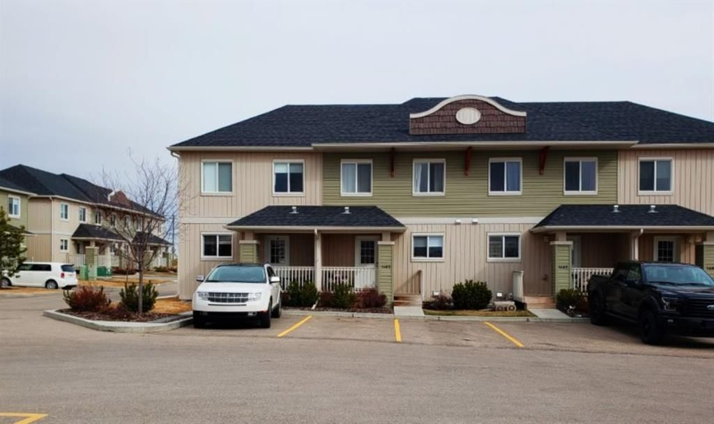 Main Photo: 1402 Clover Link: Carstairs Row/Townhouse for sale : MLS®# A1092269
