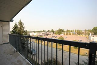 Photo 1: 404 4514 54 Avenue: Olds Apartment for sale : MLS®# A1130006