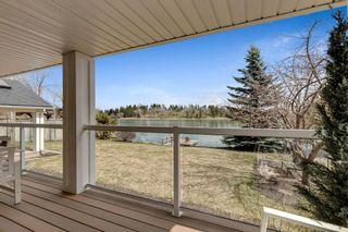 Photo 8: 664 Lake Moraine Way SE in Calgary: Lake Bonavista Detached for sale : MLS®# A1100773