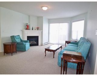 Photo 3: 108 6900 HUNTERVIEW Drive NW in Calgary: Huntington Hills Condo for sale : MLS®# C3366004