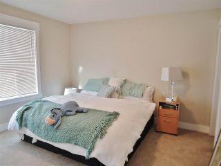 """Photo 18: 10412 109 Street in Fort St. John: Fort St. John - City NW 1/2 Duplex for sale in """"SUNSET RIDGE"""" (Fort St. John (Zone 60))  : MLS®# R2415787"""