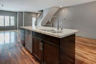 Photo 6: 2315 1 Street NE in Calgary: Tuxedo Park Row/Townhouse for sale : MLS®# A1086504