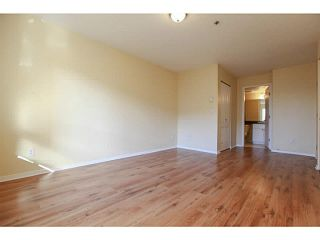 """Photo 7: 201 2340 HAWTHORNE Avenue in Port Coquitlam: Central Pt Coquitlam Condo for sale in """"BARRINGTON PLACE"""" : MLS®# V1119321"""