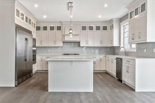 Photo 15: 211 Kinniburgh Place: Chestermere Detached for sale : MLS®# A1078763