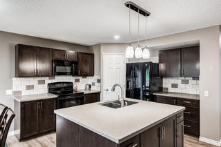 Photo 2: 133 Tuscany Meadows Place in Calgary: Tuscany Detached for sale : MLS®# A1126333