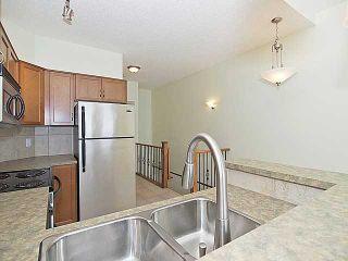 Photo 5: 16 153 ROCKYLEDGE View NW in CALGARY: Rocky Ridge Ranch Townhouse for sale (Calgary)  : MLS®# C3547157