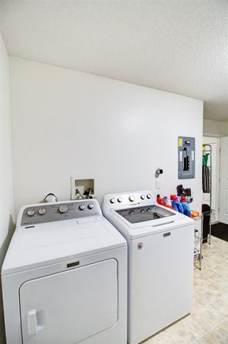 Photo 19: 209 2022 CANYON MEADOWS Drive SE in Calgary: Queensland Apartment for sale : MLS®# A1028544