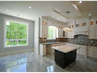 Photo 3: 15562 76A Avenue in Surrey: Fleetwood Tynehead House for sale : MLS®# F1412221