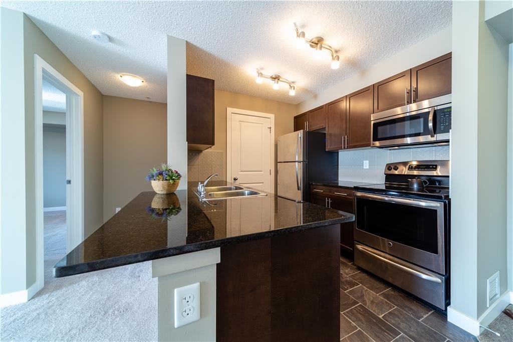 Main Photo: 3308 625 GLENBOW Drive: Cochrane Apartment for sale : MLS®# C4177591