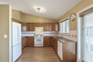 Photo 11: 426 Riverview Green: Cochrane Detached for sale : MLS®# A1132015