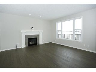 Photo 8: 78 AUBURN SPRINGS Park SE in Calgary: Auburn Bay Residential Detached Single Family for sale : MLS®# C3652537