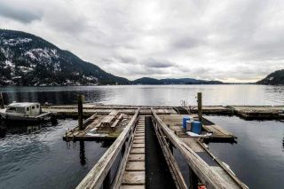 "Main Photo: 18 BRIGHTON Beach in North Vancouver: Indian Arm House for sale in ""Brighton Beach"" : MLS®# R2526167"