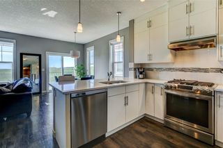 Photo 5: 2101 881 SAGE VALLEY Boulevard NW in Calgary: Sage Hill Row/Townhouse for sale : MLS®# C4305012