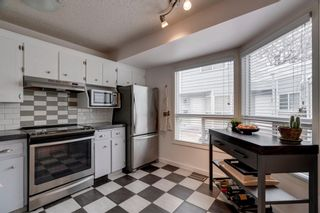 Photo 2: 5 127 11 Avenue NE in Calgary: Crescent Heights Row/Townhouse for sale : MLS®# A1063443