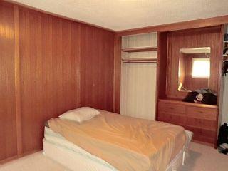 Photo 9: 208 CENTRE Avenue: Cochrane House for sale : MLS®# C4057393