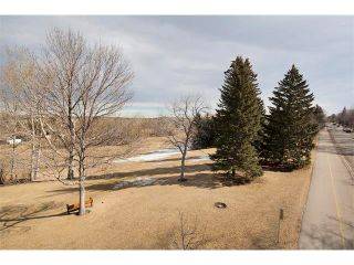 Photo 4: 3039 CANMORE Road NW in Calgary: Banff Trail House for sale