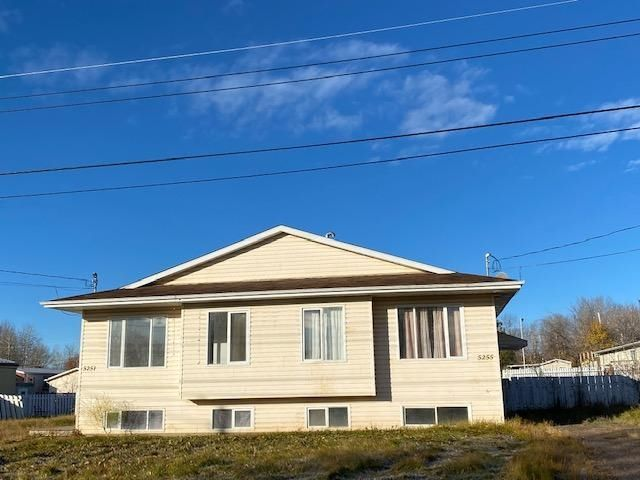 Main Photo: 5255 40 Street in Fort Nelson: Fort Nelson -Town Duplex for sale (Fort Nelson (Zone 64))  : MLS®# R2625885