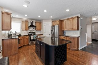 Photo 8: 1 Everglade Place SW in Calgary: Evergreen Detached for sale : MLS®# A1104677