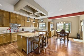 Photo 14: Spacious and Beautiful Valley Ridge Home backing out on to the Ravine