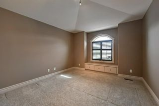 Photo 31: 32 coulee View SW in Calgary: Cougar Ridge Detached for sale : MLS®# A1117210