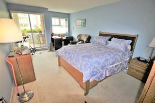 """Photo 10: 109 1230 QUAYSIDE Drive in New Westminster: Quay Condo for sale in """"Tiffany Shores"""" : MLS®# R2406017"""