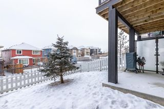 Photo 34: 703 Jumping Pound Common: Cochrane Row/Townhouse for sale : MLS®# A1064956
