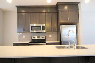 Photo 7: 296 Silverado Plains Park SW in Calgary: Silverado Row/Townhouse for sale : MLS®# A1065666