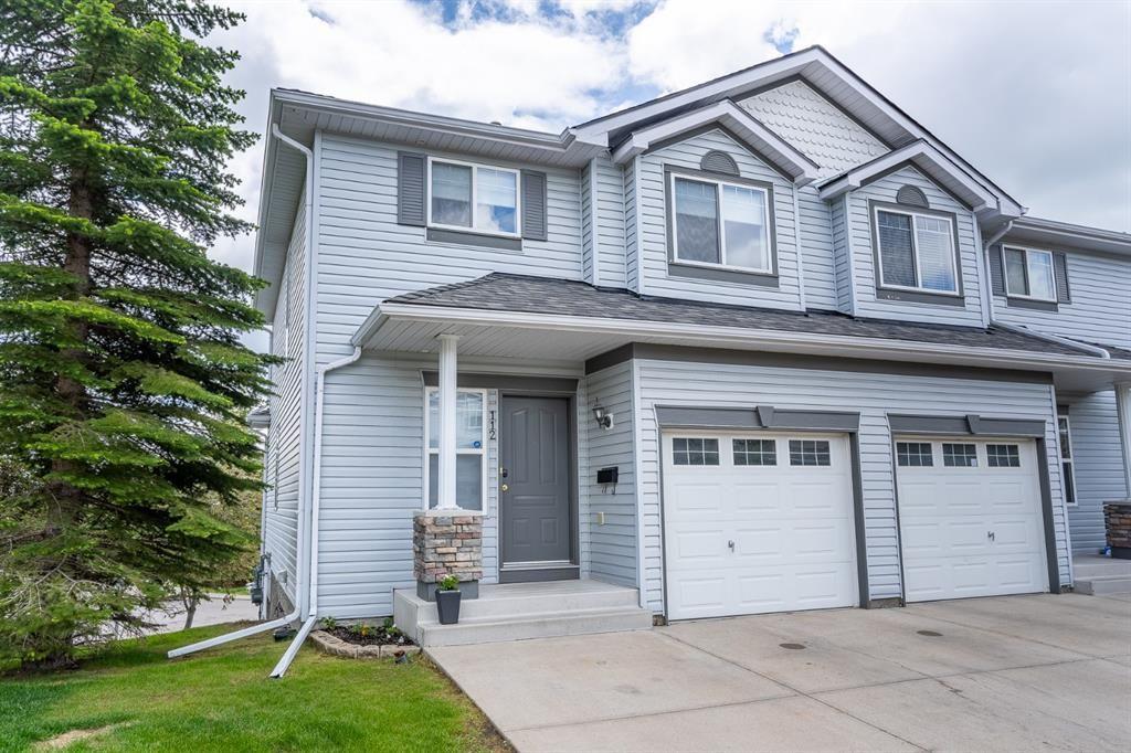 Main Photo: 112 Rocky Vista Circle NW in Calgary: Rocky Ridge Row/Townhouse for sale : MLS®# A1125808
