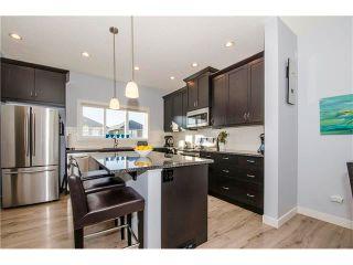 Photo 9: 587 EVANSTON Drive NW in Calgary: Evanston House for sale : MLS®# C4060637