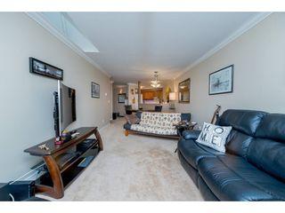 """Photo 11: 404 13876 102 Avenue in Surrey: Whalley Condo for sale in """"Glenwood Village"""" (North Surrey)  : MLS®# R2202605"""